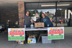 Collecting donations from patrons at Fosters Supermarket