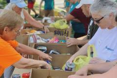 Volunteers packing food donations