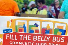Volunteers pack up food donations for transport during the 15th annual Fill the Belly Bus Community Food Drive on Friday afternoon at the Greenfield Common.