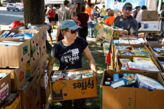 Volunteers sort through food donations during the 15th annual Fill the Belly Bus Community Food Drive on Friday afternoon at the Greenfield Common.