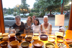 Admiring the donated bowls during Empty Bowls at the People's Pint, Greenfield MA