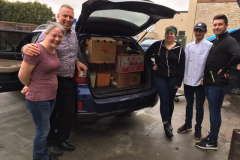 110 Grill donating food and materials