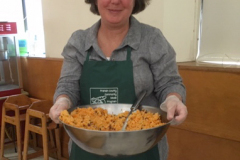 Senator Jo Commerford helping to serve meals at our Greenfield meal site