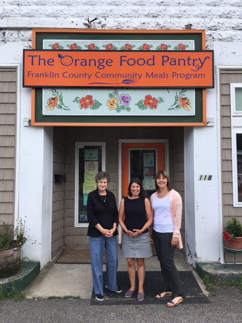 Orange Food Pantry with staff standing outside