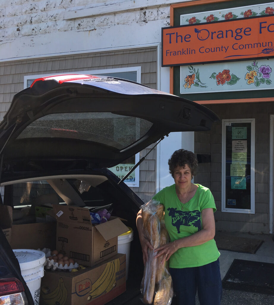 Andrea loading in food at the Orange Pantry
