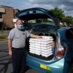 dan devine from brad's place delivering meals